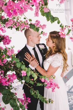 #bride #and #groom #inlove #romance #photoshoot #after #wedding #weddingideas #pink #flowers #white #weddingdress #together #oia #thira #santorini #santoriniphotographer #iosphotographer #mykonosphotographer #miltoskaraiskakis