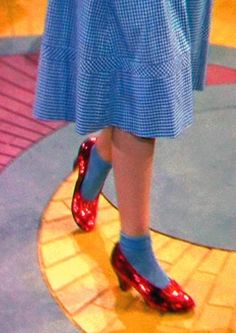 The Wizard of Oz In her ruby slippers, Dorothy takes her first steps down the yellow brick road. Wizard Of Oz 1939, Victor Fleming, Land Of Oz, Ruby Slippers, Yellow Brick Road, Judy Garland, Mellow Yellow, Color Yellow, Actresses