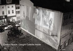 A performative artwork using CCTV systems. The CCTV follows the artist around the building in the depths of the night and the result is projected outside in the city.