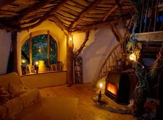 How cute is this little house? It looks like the inside of a treehouse, or maybe a house for a hobbitt. Or anyone, really, I'd stay there awhile.