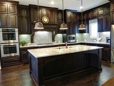 We went for dark wood kitchen designs, and the offer is diversified, so you can pick some of these according to what you wish for for your new kitchen, either built from scratch or that overdue kitchen remodel you have been saving for. Go modern, rustic or minimalist and contemporary, and your kitchen will look great according to our books but remember you have the last saying. The most important part is that among these dark wood kitchen designs you find the kitchen you have been looking… Dark Wood Kitchen Cabinets, Dark Wood Kitchens, Wood Floor Kitchen, Kitchen Flooring, New Kitchen, Cool Kitchens, Kitchen Decor, Wood Flooring, Kitchen Ideas