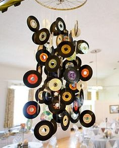 DIY Idea Vinyl Up Your Life....Cool Music-themed Chandelier/Mobile... ofcourse just the ones not to usable on our turntable