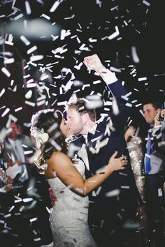 Bride and groom celebrating getting married with confetti @myweddingdotcom