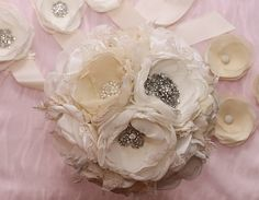 Ivory fabric bouquet, wrist corsage and single bloom boutonnière.