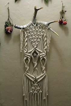 could do this with weaving  Macramé Wall Hanging on Deer Antlers with Crystals and Pyrite