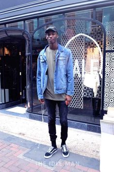 Men's Street Style | Cool Denim - Get some ripped black jeans with a basic t-shirt and a light blue denim jacket. Finish the outfit with some Old School Vans and a cap. | Shop the look at The Idle Man