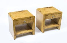 A charming pair of birdseye maple cabinets in the Art Deco style.