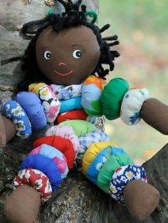 In simpler days, Caribbean children enjoyed playing with homemade dolls crafted from fabric remnants and scrap materials. These much loved dolls depicted people from everyday life dressed in typical local costumes. Their homespun, honest charm has remained intact through today's fast paced, high-tech times.  This doll has been handmade using traditional Caribbean designs, textiles and decorations. Each doll is an original design inspired by historic examples of early Caribbean folk dolls. 3+