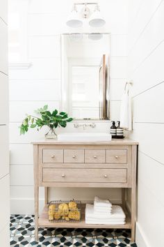 Wide shiplap planks, bleached oak vanity and cement tile floors || Studio McGee