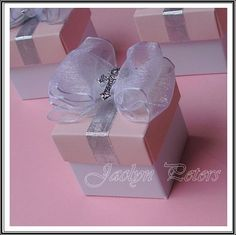 Baby Girl Baptism Or Communion Cross And Bow Favor Box. $4.10, via Etsy.