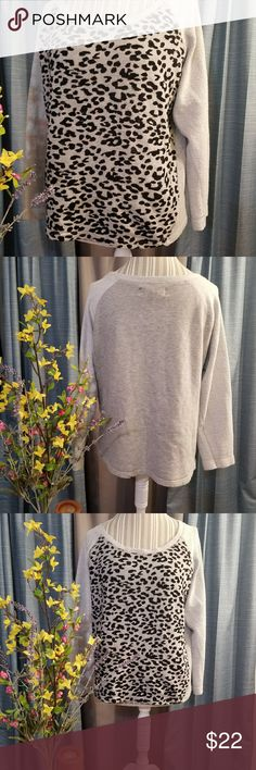 🌻🌺🌻FRENCH LAUNDRY CHEETAH/LEOPARD PRINT SWEATER SIZE:large   BRAND:French Laundry   CONDITION:like new, no flaws    COLOR:light gray/black  Black print has velvet feel   🌟POSH AMBASSADOR, BUY WITH CONFIDENCE!   🌟CHECK OUT MY OTHER ITEMS TO BUNDLE AND SAVE ON SHIPPING!   🌟OFFERS WELCOME!   🌟FAST SHIPPING! French laundry Tops