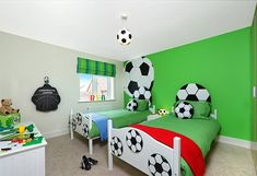 Sports Themed Bedrooms Football Theme With Football Wallpaper And Ball Ceiling Lighting And Beds