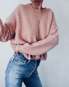 light pink sweater and mom jeans