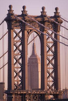 pinterest.com/fra411 #NYC - Empire State Building seen through Manhattan Bridge, NY, photo by Georgianna Lane
