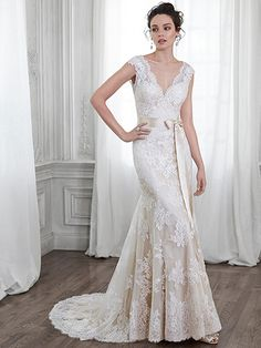 Maggie Sottero - SHAYLA, Dreamy lace and tulle adorn this slim A-line wedding dress with dramatic V-neckline and back, accented with scallops. Finished with covered button over zipper closure.