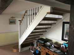 An oak open rise staircase with painted strings and posts. Open Stairs, Glass Stairs, Metal Stairs, Painted Stairs, Bespoke Staircases, Wooden Staircases, Curved Staircase, Staircase Design