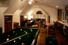 Classic game room design, complete with a pool table. Discovered on www.Porch.com