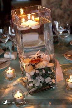 Floating candles at a beach themed reception @Laura Jayson Jayson Haskenhoff -- use all those vases.. instead of all those flowers. simple and cute.