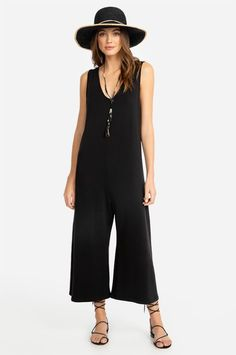 For effortless elegance, look no further than our oh-so-chic and cozy Fleece Easy Jumpsuit, crafted from the softest organic cotton and lighter-than-air Tencel. The on-trend wide-leg fit and subtle v-neckline make styling a breeze — no matter the occasion Resort Style, Black Jumpsuit, Organic Cotton, Wide Leg, Legs, Elegant, Chic, Fabric, Pants