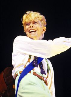 David Bowie performing on stage during a European tour 1983, he loved to have fun always.