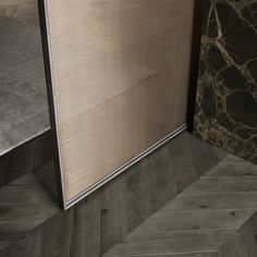 """Velaria"" Sliding Door by Rimadesio. Detail with brushed lead structure and panels in the new bronze net glass."
