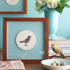 I love this idea! Turn inexpensive coasters into graphic wall art. Tape pretty letterpress coasters to colorful card stock and display in ready-made frames. Create a shadowbox effect with a thick round coaster in a crisp square frame. For a more traditional look, add a precut mat.