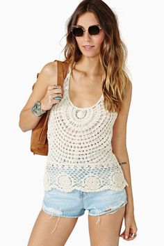 The perfect vintage-inspired ivory crochet top featuring a tied halter neckline and scalloped hem.