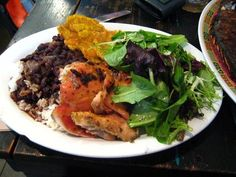 Sol Food: organic Puerto Rican cuisine in San Rafael.  Get the Pollo Al Horno - stewed chicken thighs with bean, rice, salad, and fried plantains.