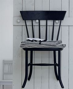black chair on the wall