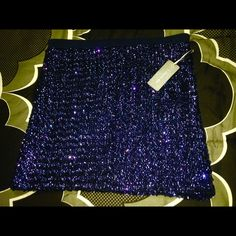 Price Drop $10 LOVE H81 Mini skirt I LOVE H 81 royal blue sequin skirt with thick waistband n lining ...NWT .. This is a made by Forever 21 skirt...Stretchy I Love H81 Skirts Mini