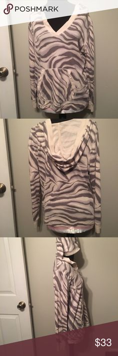 Zebra print hoodie Chaps brand zebra print hoodie. V neck. SZ L Cream with light gray stripes. Lightweight 100% cotton. Big pocket in front. Very cute. Like new. Tops Sweatshirts & Hoodies