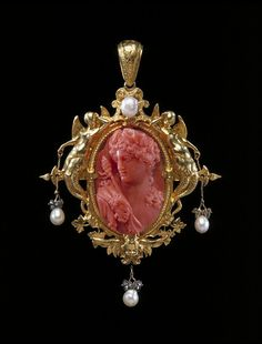 1854 Bacchus pendant - Coral, carved as a cameo, and set in a gold frame hung with pearls and rose-cut diamond sparks set in silver.