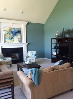 I love the rich color in this family room...Underseas by Sherwin Williams... Designed by Transformed Interiors