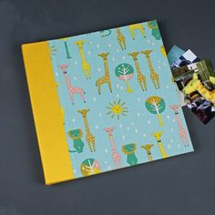 Fotoalbum-gelb-türkis-Löwe-und-Giraffe  baby photoalbum yellow green