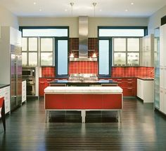 COLOR: island, cabinets, and backsplash.  Warm red tones.  Do Not like the legs on the island or that it lacks a lip, preventing you from sitting next to it