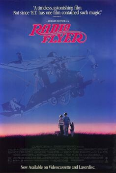Radio Flyer , starring Lorraine Bracco, John Heard, Adam Baldwin, Elijah Wood. A father recounts a dark period of his childhood when he and his little brother lived in the suburbs. #Drama