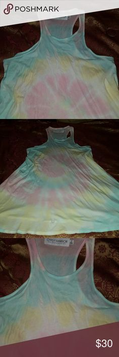 Gypsy warrior tie dye sun dress cover up Tie dye brand new never worn gupsy warrior brand sundress. Racerback-tank style pastel colors in yellow, blue, and pink. So precious and material is so soft. Fit is small and truw to size but could probably fit a medium! Ive only tried on, i took the tags off and never wore out. In like new condition. Bought at pacsun PacSun Dresses