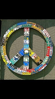 Peace sign out of license plate.