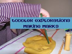 Toddler Explorations with mark making in playdough