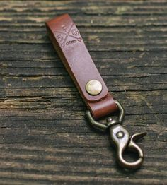 As functional as it is fetching, this leather key fob can help you out with that key losing problem. Clip the brass hardware to a belt loop or snap the leather bit around a bag strap to keep them in plain sight. The leather keychain comes in your choice of saddle, mocha, black or natural colored vegetable tan leather, which will patina over time, aging with character.