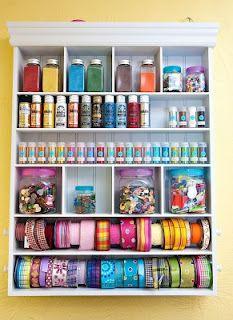 organizing ribbon, paints, buttons  glitter.