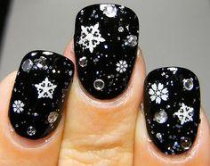 Beautiful black and silver snowflake nails