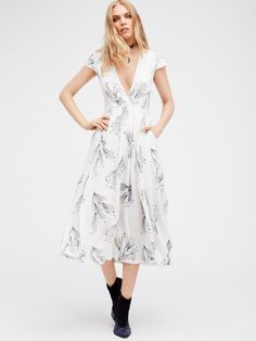 Printed Retro Midi Dress   Pretty short sleeve midi dress with a delicate femme print. Wrapped V-neckline. Super soft and lightweight fabrication. Hidden side zipper closure. Fully lined.