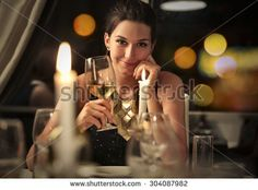 Beautiful girl holding a glass of vine