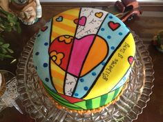 Happy 17th anniversary Gilberto - Chocolate cake, filled with chocolate ganache and chocolate drops, covered with fondant. Hand painted copying a piece of Romero Britto. Love the concept anc color of his work.