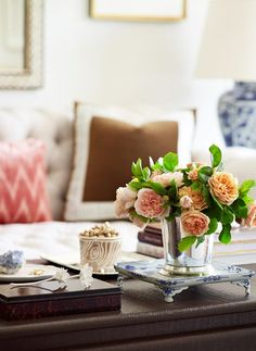 Live this silver vase and flower arrangement. Might have to do this + stack of books for the kitchen table!