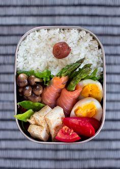 Shimeji Salmon bento ~ cooked rice with umeboshi, tomato, mangetout, tofu with shichimi, hard-boiled egg, sauteed asparagus wrapped in smoked salmon, sauteed shimeji mushrooms...