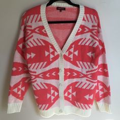 • aztec print cardigan • NWOT Coral and cream, aztec/native print, knitted, oversized cardigan. Button downs. PERFECT condition- NO flaws/ tears/ rips/ piling. No trades, thanks Urban Outfitters Sweaters Cardigans