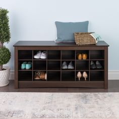 Get rid of those shoes cluttering up your hallway with this durable storage cubbie bench. Eighteen cubbie holes across the piece provide ample room for storage of your family's shoes, and its flat top serves as a bench, helping you get ready.