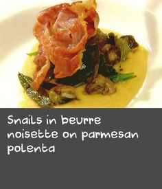 "Snails in beurre noisette on parmesan polenta | Polenta is a fantastic pantry staple as it is quite easy to prepare. In this Italian dish the polenta is served with snails cooked in beurre noisette, literally ""hazelnut butter"". The butter is cooked until golden brown and nutty in fragrance, then lemon juice and rind are added making a delicious pan sauce for the dish."